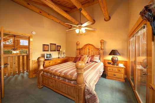 third floor bedroom with queen bed at hibernation hideaway #745 a 2 bedroom cabin rental located in pigeon forge