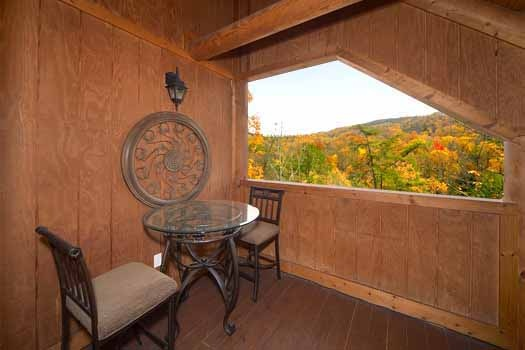 Table and chairs on third floor at Hibernation Hideaway #745, a 2-bedroom Pigeon Forge cabin rental