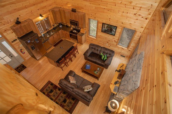 Looking down onto the main floor at Happy Bear's Hideaway, a 2 bedroom cabin rental located in Gatlinburg