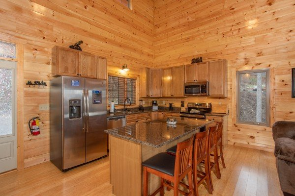 Kitchen with stainless appliances and breakfast bar at Happy Bear's Hideaway, a 2 bedroom cabin rental located in Gatlinburg
