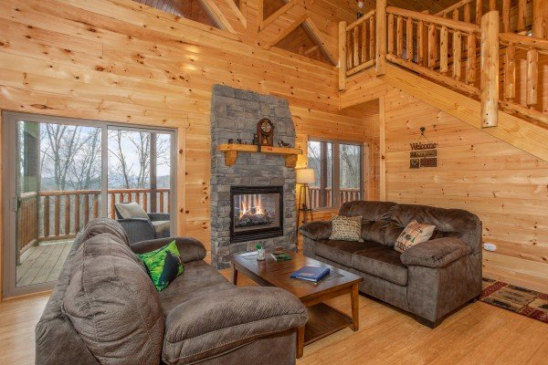 Living room with see through fireplace at Happy Bear's Hideaway, a 2 bedroom cabin rental located in Gatlinburg