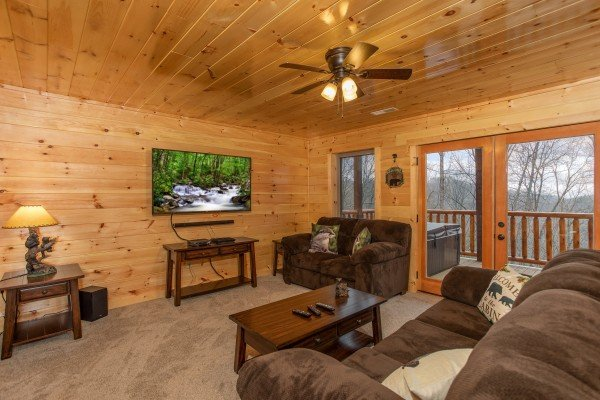 Media room on the lower floor at Happy Bear's Hideaway, a 2 bedroom cabin rental located in Gatlinburg