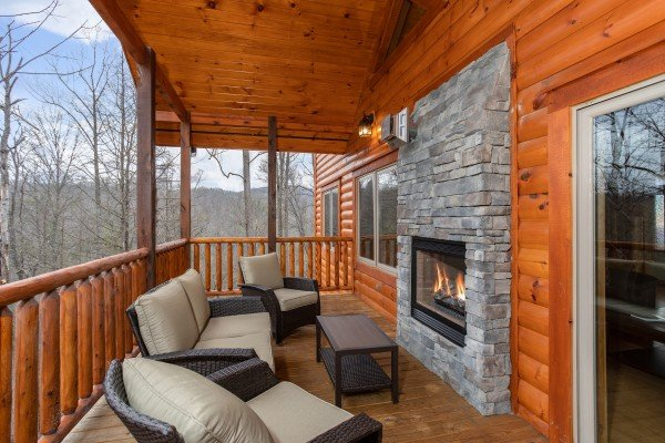 Outdoor seating area with see through fireplace at Happy Bear's Hideaway, a 2 bedroom cabin rental located in Gatlinburg