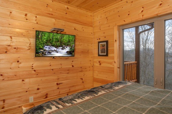 Wall mounted TV at Happy Bear's Hideaway, a 2 bedroom cabin rental located in Gatlinburg