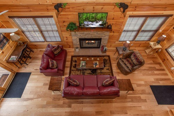 Looking down on the living room from the loft at Moonlight Inn Gatlinburg, a 2 bedroom cabin rental located in Gatlinburg