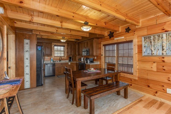Dining space with seating for six at Moonlight Inn Gatlinburg, a 2 bedroom cabin rental located in Gatlinburg