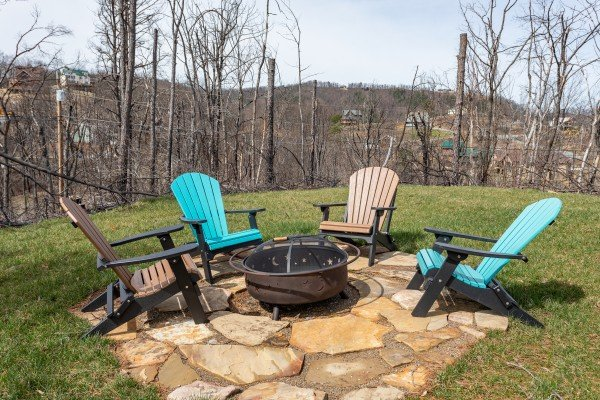 Fire pit and Adirondack chairs at Moonlight Inn Gatlinburg, a 2 bedroom cabin rental located in Gatlinburg