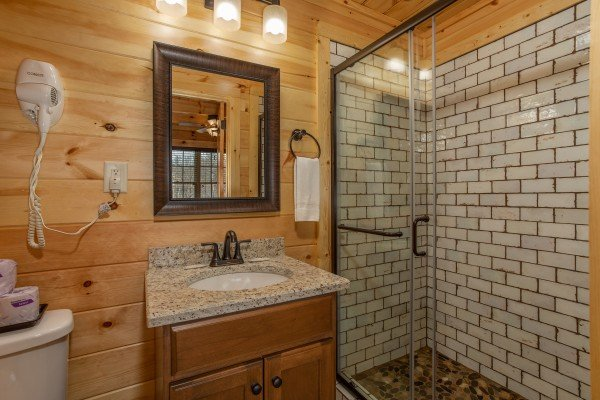 Glassed shower at Moonlight Inn Gatlinburg, a 2 bedroom cabin rental located in Gatlinburg