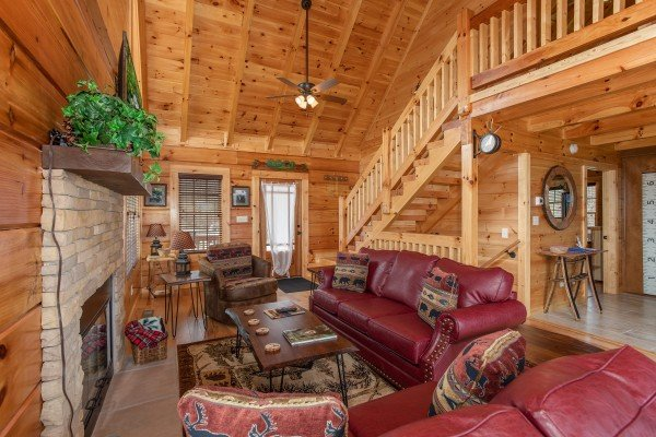 Living room with seating at Moonlight Inn Gatlinburg, a 2 bedroom cabin rental located in Gatlinburg