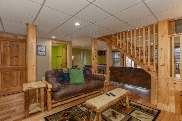Futon in the lower living space at Moonlight Inn Gatlinburg, a 2 bedroom cabin rental located in Gatlinburg