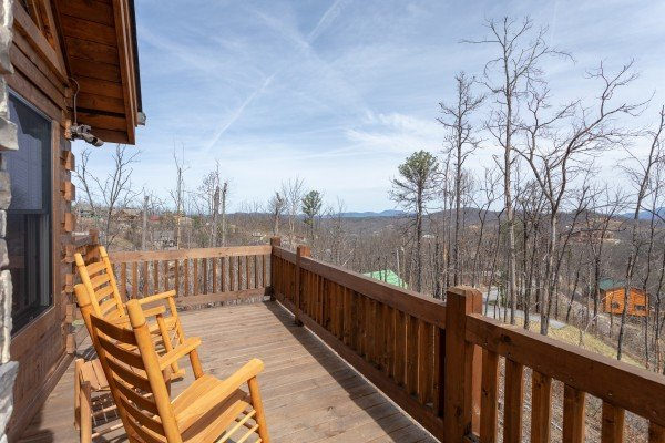 Mountain views from the rocking chairs on the deck at Moonlight Inn Gatlinburg, a 2 bedroom cabin rental located in Gatlinburg