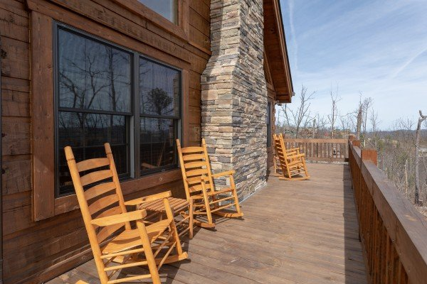 Rocking chairs on the wrap around deck at Moonlight Inn Gatlinburg, a 2 bedroom cabin rental located in Gatlinburg