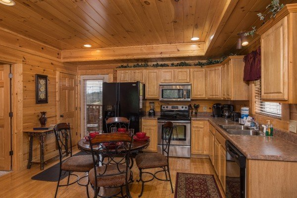 Dining space for four in the kitchen at Heaven on Earth, a 2-bedroom cabin rental located in Pigeon Forge