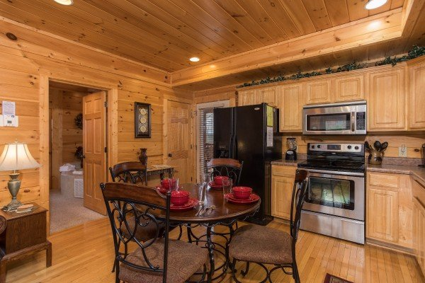 Dining table for four in the kitchen at Heaven on Earth, a 2-bedroom cabin rental located in Pigeon Forge