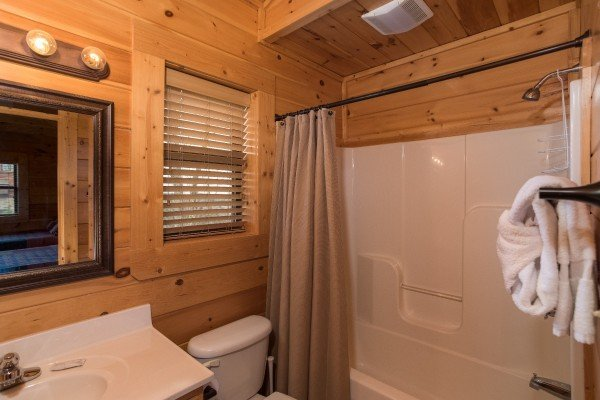 Bathroom with a tub and shower at Heaven on Earth, a 2-bedroom cabin rental located in Pigeon Forge