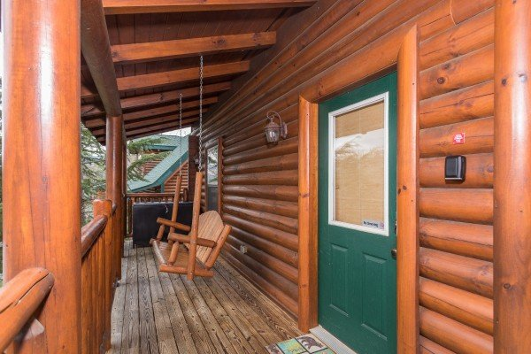 Front porch with a swing at Heaven on Earth, a 2-bedroom cabin rental located in Pigeon Forge