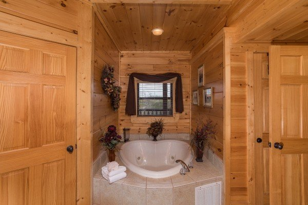 Heart-shaped jacuzzi in the first floor bathroom at Heaven on Earth, a 2-bedroom cabin rental located in Pigeon Forge