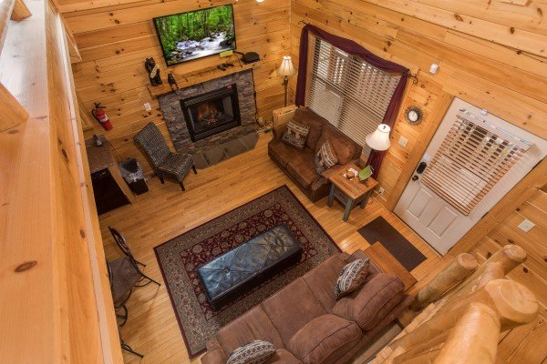 Looking down from the loft to the living room at Heaven on Earth, a 2-bedroom cabin rental located in Pigeon Forge