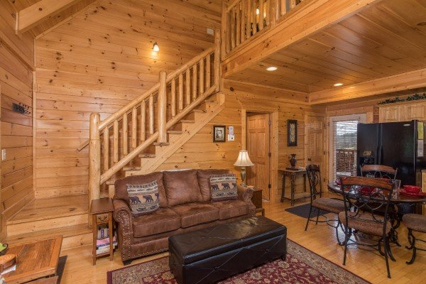 Living room, dining space, and kitchen on the first floor at Heaven on Earth, a 2-bedroom cabin rental located in Pigeon Forge