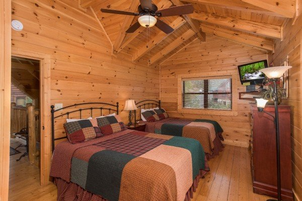Bedroom with two queen beds at Heaven on Earth, a 2-bedroom cabin rental located in Pigeon Forge