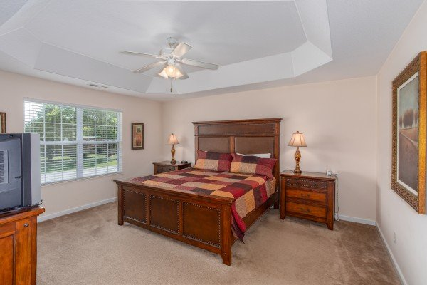 Bedroom with tray ceiling at A Pigeon Forge Retreat, a 2 bedroom cabin rental located in Pigeon Forge