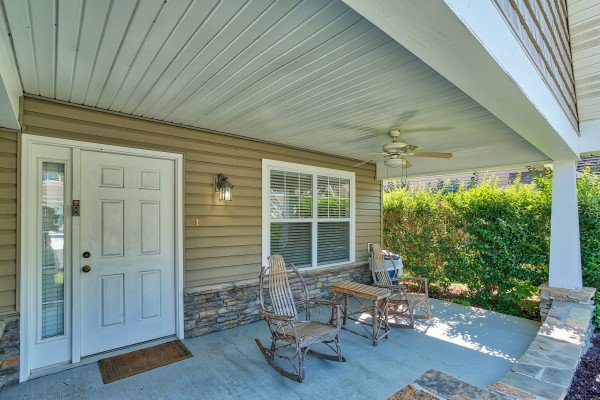 Front porch with rocking chairs at A Pigeon Forge Retreat, a 2 bedroom cabin rental located in Pigeon Forge
