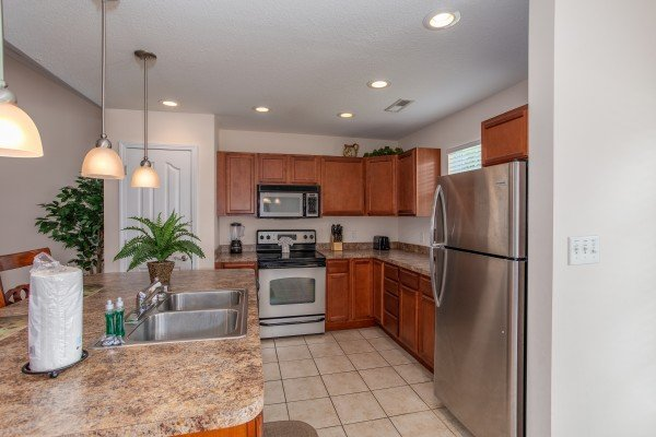 Kitchen with stainless steel appliances at A Pigeon Forge Retreat, a 2 bedroom cabin rental located in Pigeon Forge