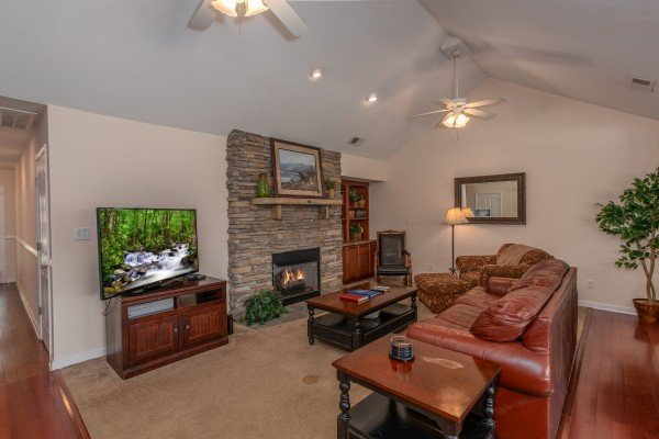 Living room with fireplace and television at A Pigeon Forge Retreat, a 2 bedroom cabin rental located in Pigeon Forge