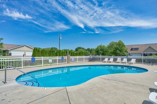 Pool with lounge chairs at A Pigeon Forge Retreat, a 2 bedroom cabin rental located in Pigeon Forge