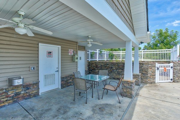 Seating at the outdoor pool deck at A Pigeon Forge Retreat, a 2 bedroom cabin rental located in Pigeon Forge
