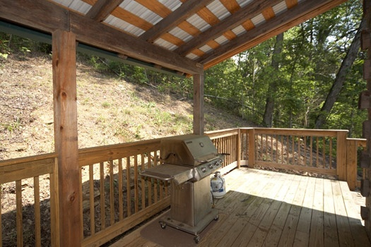 covered deck with girll at mountain lake escape a 3 bedroom cabin rental located in douglas lake