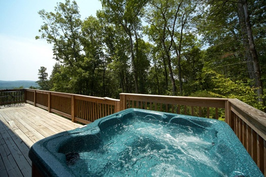 deck with hot tub at mountain lake escape a 3 bedroom cabin rental located in douglas lake