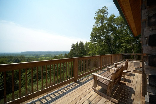 deck with rocking chairs and view at mountain lake escape a 3 bedroom cabin rental located in douglas lake