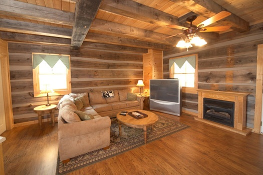 living room with fireplace at mountain lake escape a 3 bedroom cabin rental located in douglas lake