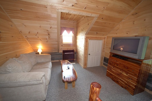 seating area in king bedroom at mountain lake escape a 3 bedroom cabin rental located in douglas lake