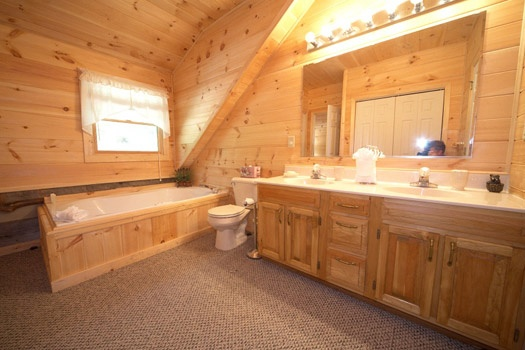 third floor bathroom with jacuzzi tub at mountain lake escape a 3 bedroom cabin rental located in douglas lake