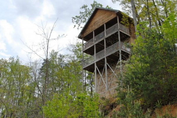 Looking up at the cabin from down the hill at Lookout Ridge, a 2 bedroom cabin rental located in Pigeon Forge