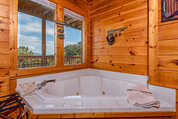 Jacuzzi tub in the corner of the queen bedroom at Lookout Ridge, a 2 bedroom cabin rental located in Pigeon Forge