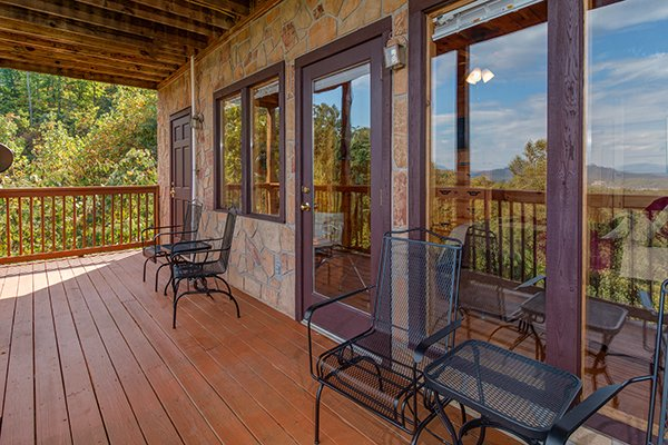 Four chairs on a deck at Lookout Ridge, a 2 bedroom cabin rental located in Pigeon Forge