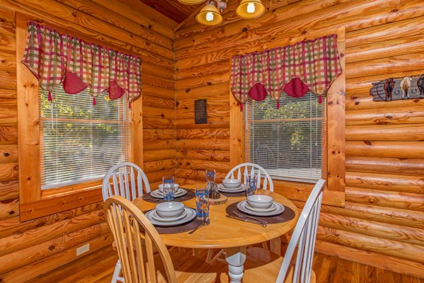 Dining room with seating for four at Lookout Ridge, a 2 bedroom cabin rental located in Pigeon Forge