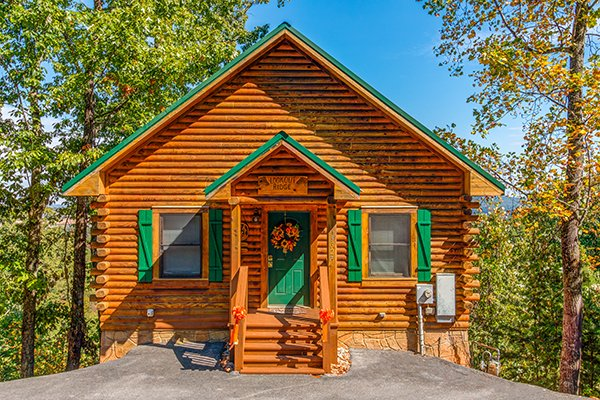 Looking at the cabin from the parking pad at Lookout Ridge, a 2 bedroom cabin rental located in Pigeon Forge