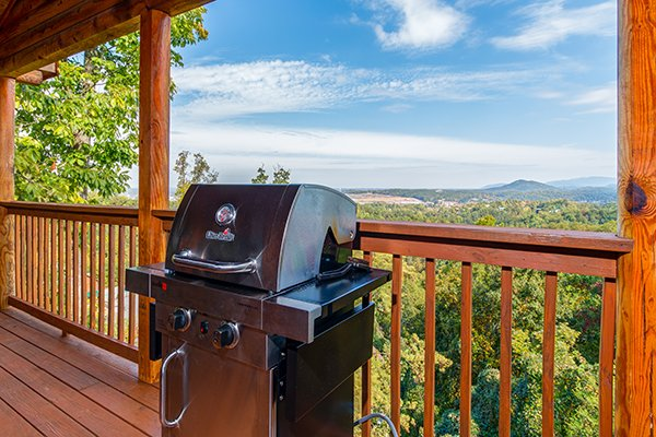 Grill on the covered deck at Lookout Ridge, a 2 bedroom cabin rental located in Pigeon Forge