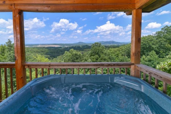 Looking out on the mountain view from the hot tub at Lookout Ridge, a 2 bedroom cabin rental located in Pigeon Forge