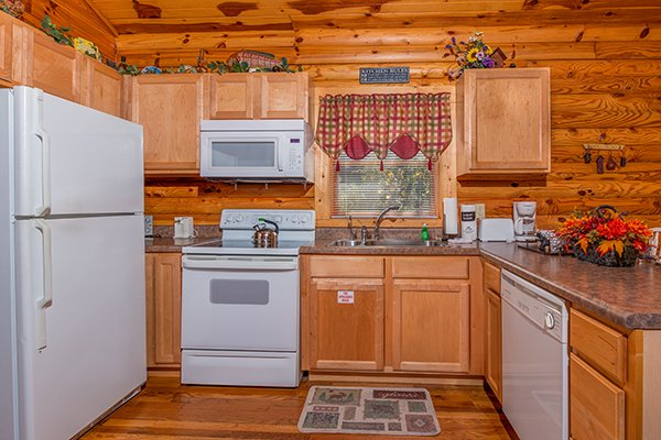 Kitchen with white appliances at Lookout Ridge, a 2 bedroom cabin rental located in Pigeon Forge