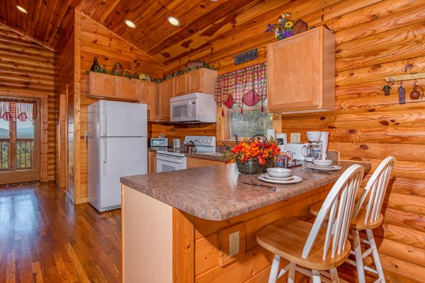 Kitchen with breakfast bar seating for two at Lookout Ridge, a 2 bedroom cabin rental located in Pigeon Forge