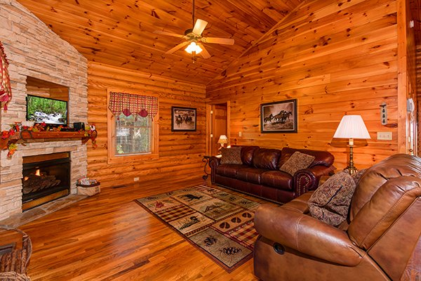 Living room with sofa, fireplace, and TV at Lookout Ridge, a 2 bedroom cabin rental located in Pigeon Forge