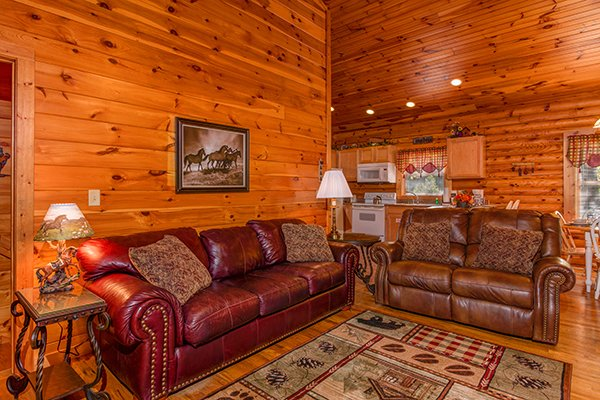 Living room with a sofa and loveseat at Lookout Ridge, a 2 bedroom cabin rental located in Pigeon Forge