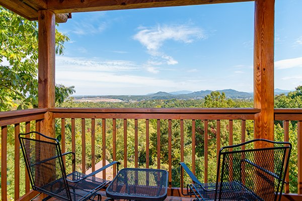 Mountain view from the covered deck at Lookout Ridge, a 2 bedroom cabin rental located in Pigeon Forge
