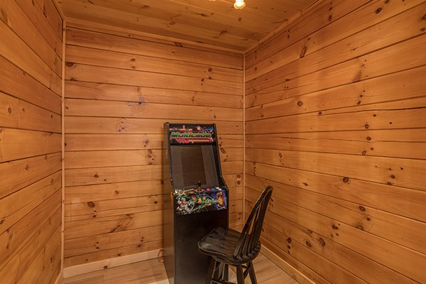Arcade game at Shangri-lodge, an 8 bedroom cabin rental located in Pigeon Forge