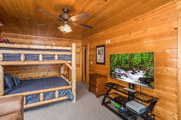 Bunk room with TV and game systems at Shangri-lodge, an 8 bedroom cabin rental located in Pigeon Forge